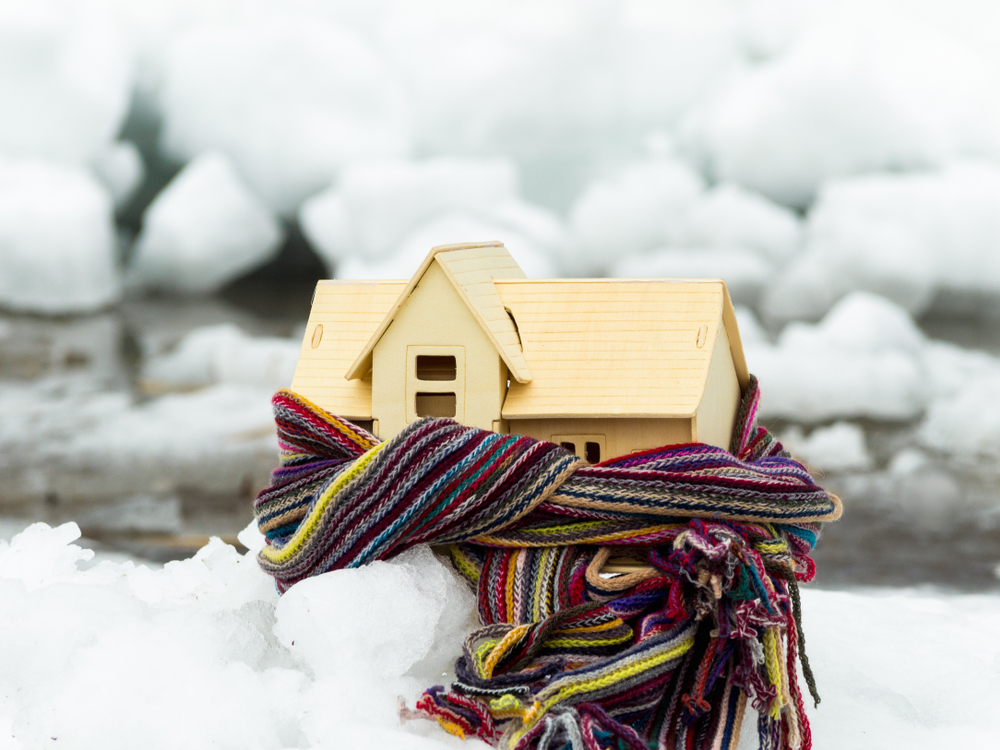 Wooden House Model Wrapped in a Scarf